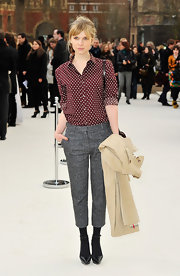 Clemence Poesy kept her style on trend in a pair of cropped tweed trousers and a dotted blouse.