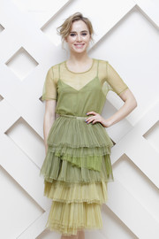 Suki Waterhouse looked whimsical in a seafoam-green Burberry dress, featuring a sheer T-shirt bodice and a tiered skirt, during the Beauty Box event in Seoul.