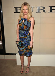 Kate Bosworth spiced up her stunning printed frock with a green studded wristlet at the Burberry Body launch.