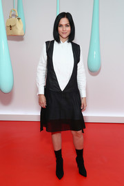 Leigh Lezark teamed her dress with pointy black mid-calf boots.