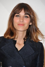 Alexa Chung wore a pretty peachy pink lip balm at the Burberry boutique opening in Paris.