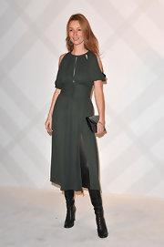 Audrey Marny wore a muted green dress with a hip-high slit and shoulder slashes for the Burberry Paris Boutique opening.