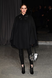 Olivia Palermo cut a stylish figure in a black Burberry wool cape teamed with leather pants during the label's fashion show.
