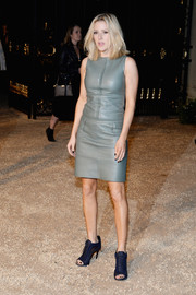 Ellie Goulding continued the edgy vibe with a pair of midnight-blue lace-up booties, also by Burberry.