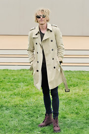 Jamie Campbell Bower wore a classic tan trench while attending the Burberry Mens Runway Show.