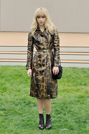Suki Waterhouse wore a snakeskin-print raincoat while attending the Burberry Men's Runway Show.