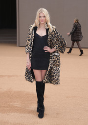 Rocking a mini skirt and cami combo at the Burberry show, Lily Donaldson added warmth via a leopard-print fur coat.