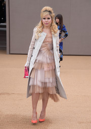 Paloma Faith got all frilled up in this Burberry confection, featuring tiers of fabric in neutral tones, for the brand's fashion show.