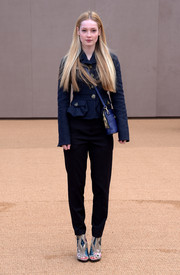 Laura Hayden attended the Burberry fashion show wearing a navy cropped jacket from the label.