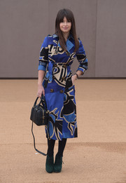 Miroslava Duma did a bit of color blocking, pairing her blue coat with green suede lace-up booties.