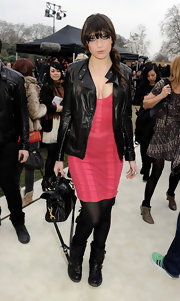 Daisy Lowe toughened up a berry bodycon dress with black leather motorcycle boots.
