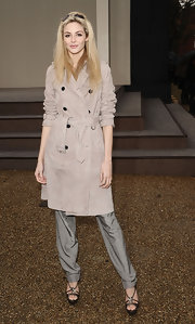 Tamsin Egerton donned a stylish casual look at the Burberry Prorsum LFW show wearing a trenchcoat, silk pants, and a pair of strappy platforms.