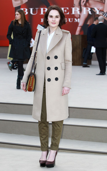 Michelle Dockery stuck to her classic style with a tan wool coat with oversized black buttons at the Burberry Prorsum runway show in London.