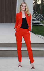 Rosie Huntington-Whitely rocked a red pant suit at the Burberry runway show in London.