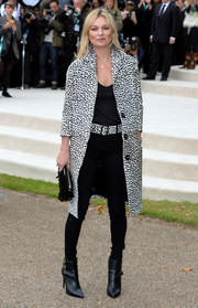 Pointy black ankle boots by Burberry sealed off Kate Moss' edgy-chic attire.