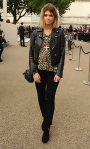 Showcasing her signature kick ass style, Pixie hit the Burberry fashion show in a luxe leather jacket.