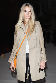 Cara Delevingne was seen at the Burberry Menswear presentation wearing a leather-sleeved trenchcoat.