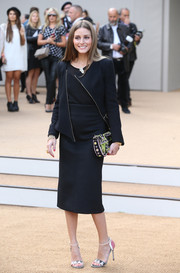 Olivia Palermo looked seriously chic in this modern black skirt suit during the Burberry Prorsum fashion show.