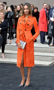 Jourdan Dunn couldn't be missed in her uber-stylish orange Burberry trenchcoat during the label's fashion show.