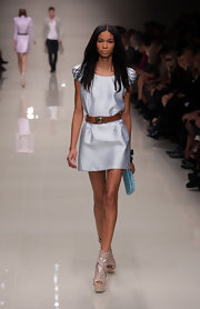 Burberry does Chanel! She is wearing a simple light blue dress with killer peep toe heels. The shoes are fanatstic and mix different types of leather for its unique look. Burberry put this look together well. The pastel colors are great with her skin tone.