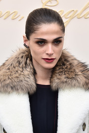 Elisa Sednaoui slicked her hair back into a Croydon facelift for the Burberry fashion show.