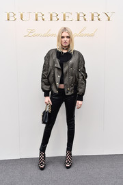 Lily Donaldson toughened up in a bulky gray bomber jacket by Burberry for the label's fashion show.