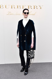 Erin O'Connor bundled up in style in a blue Burberry fur cape for the label's fashion show.