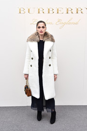 Elisa Sednaoui made a luxurious entrance in a Burberry two-tone fur coat during the label's fashion show.
