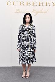 Leigh Lezark stepped out for the Burberry fashion show wearing a printed trenchcoat from the label.