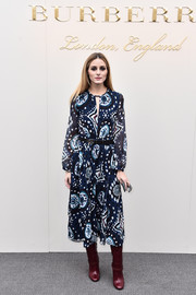 Olivia Palermo went for boho cuteness in a long-sleeve print dress by Burberry when she attended the label's fashion show.