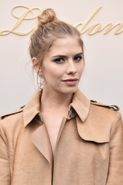 Elena Perminova attended the Burberry fashion show rocking a messy top knot.