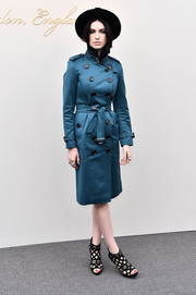 Tali Lennox cut a stylish figure in a blue Burberry trenchcoat as she arrived for the label's fashion show.