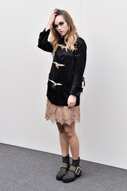 Suki Waterhouse donned a black Burberry toggle jacket for the label's fashion show.