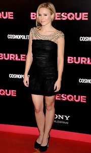 Kristen Bell pared a lovely bead and mesh embellished LBD with black satin platforms.