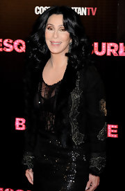 Cher was all glammed up in a sequined black jacket with fur lapels when she attended the 'Burlesque' premiere in Madrid.
