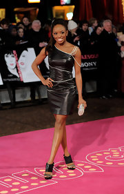 Chelsea dons a one-shoulder leather dress with rhinestone embellishments.