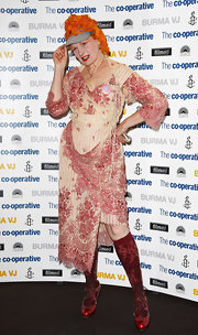 Vivienne Westwood went for a demure, ladylike look with this floral dress at the 'Burma VJ' premiere.
