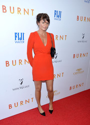 Helena Christensen put on a leggy display in a bright red mini dress during the New York premiere of 'Burnt.'