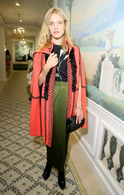 Natalia Vodianova arrived for the Buro 24/7 Family Presentation wearing a charming coral coat with black stitching.