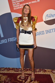 Anna dello Russo went playful in an embroidered mini dress with puffed sleeves and bowed shoulders for the Buro 24/7 Fashion Forward Initiative.