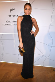 Jasmine Sanders styled her dress with an elegant black and gold box clutch.