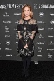 Brittany Snow contrasted her ladylike outfit with edgy black booties by Loeffler Randall.
