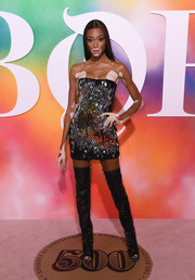 Winnie Harlow sealed off her sexy look with black thigh-high boots.