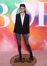 Black patent boots rounded out Taylor Hill's ensemble.