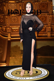 Ulyana Sergeenko complemented her top with a high-slit black maxi skirt.