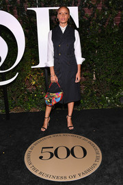 Adwoa Aboah was business-chic in a Thom Browne pinstriped coat dress layered over a white shirt at the #BoF500 gala.