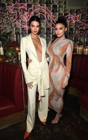 Kylie Jenner wrapped her curves in a printed turtleneck dress by Celine for the Business of Fashion dinner.