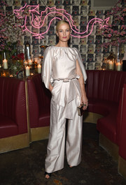 Carolyn Murphy attended the Business of Fashion dinner wearing a pale pink cape-sleeve blouse.