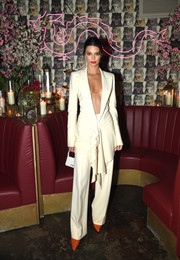 Kendall Jenner was white-hot in a plunging pantsuit by Jean Paul Gaultier Couture at the Business of Fashion dinner.