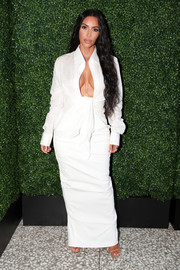 Kim Kardashian flaunted her cleavage in a low-cut tie-front shirt by Jacquemus at the inaugural BoF West Summit.